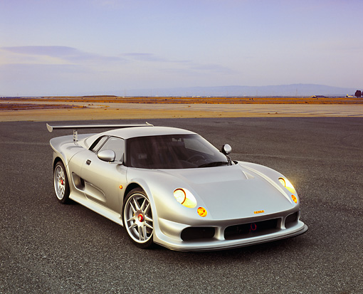 AUT 38 RK0232 01 © Kimball Stock 2003 GSR Noble M12 GTO Silver 3/4 Front View On Pavement Filtered