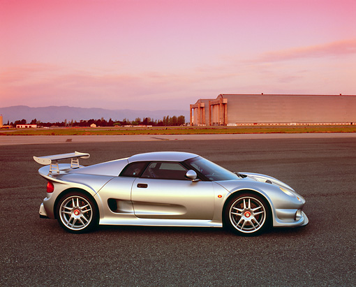 AUT 38 RK0240 01 © Kimball Stock 2003 GSR Noble M12 GTO Silver Profile On Pavement Filtered