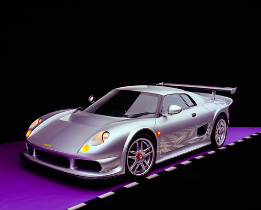 AUT 38 RK0243 13 © Kimball Stock 2003 GSR Noble M12 GTO Silver 3/4 Front View On Purple Floor Checkered Line Studio