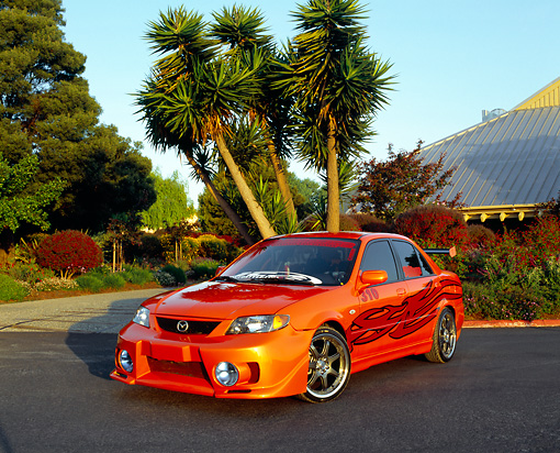 AUT 38 RK1863 01 © Kimball Stock 2003 Mazda Protege Orange With Red Flames Custom