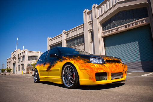 AUT 38 RK1882 01 © Kimball Stock 2003 Volkswagen GTI 20th Anniversary Yellow With Flames Low 3/4 Front View On Pavement