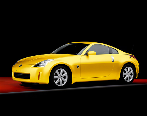 AUT 38 RK1897 01 © Kimball Stock 2003 Nissan 350Z Yellow 3/4 Front View Studio