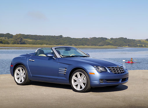 AUT 39 RK0329 01 © Kimball Stock 2004 Chrysler Crossfire Convertible Blue 3/4 Side View On Pavement By Water