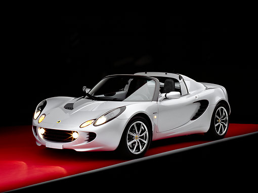 AUT 39 RK0017 08 © Kimball Stock 2004 Lotus Elise Silver 3/4 Front View On Red Floor Gray Line Studio