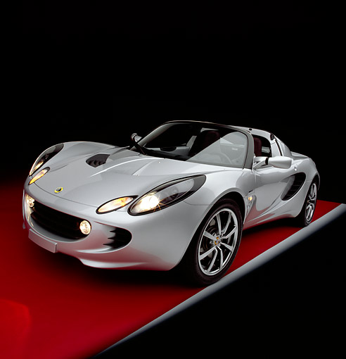 AUT 39 RK0018 30 © Kimball Stock 2004 Lotus Elise Silver Wide Angle 3/4 Front View On Red Floor Gray Line Studio