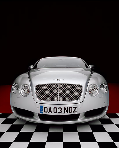 AUT 39 RK0120 19 © Kimball Stock 2004 Bentley Continental GT Silver Wide Angle Head On Shot On Checkered And Red Floor Studio