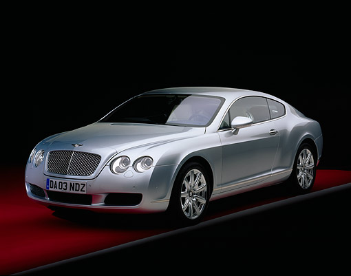 AUT 39 RK0122 01 © Kimball Stock 2004 Bentley Continental GT Silver 3/4 Front View On Red Floor Gray Line Studio