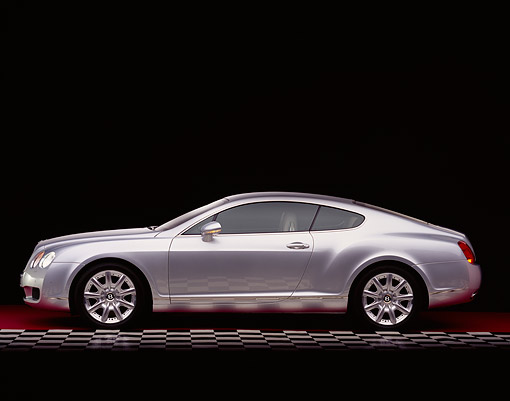 AUT 39 RK0125 09 © Kimball Stock 2004 Bentley Continental GT Silver Side View On Checkered And Red Floor Studio