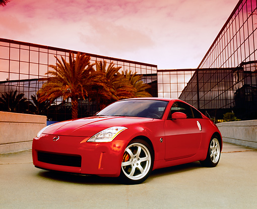 AUT 39 RK0139 05 © Kimball Stock 2004 Nissan 350Z Track Red  Low 3/4 Front View On Pavement By Building Filtered