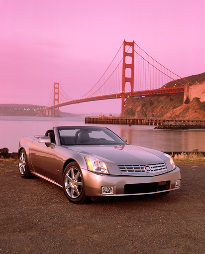 AUT 39 RK0005 06 © Kimball Stock 2004 Cadillac XLR Convertible Shale Metallic Front 3/4 Front By Golden Gate Bridge Filtered