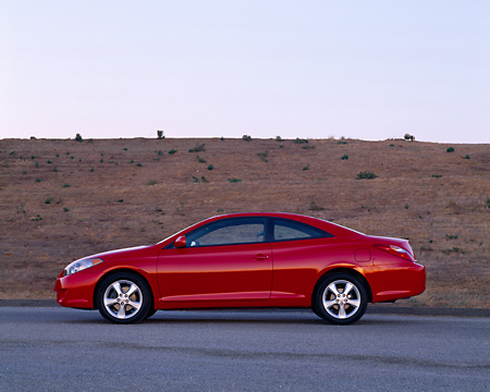 AUT 39 RK0052 01 © Kimball Stock 2004 Toyota Camry Solara Red Profile View On Pavement By Hill