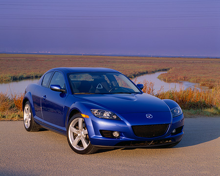 AUT 39 RK0064 06 © Kimball Stock 2004 Mazda RX-8 Blue 3/4 Front View On Pavement By Marsh Purple Sky