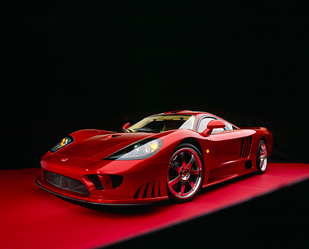 AUT 39 RK0080 06 © Kimball Stock 2004 Saleen S7 Red Wide Angle Shot 3/4 Front View On Red Floor Studio