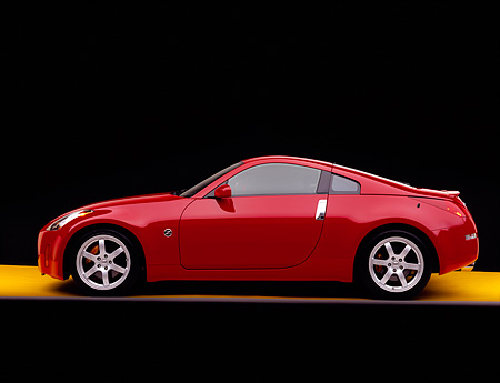 AUT 39 RK0146 07 © Kimball Stock 2004 Nissan 350Z Coupe Track Red Profile On Yellow Floor Studio