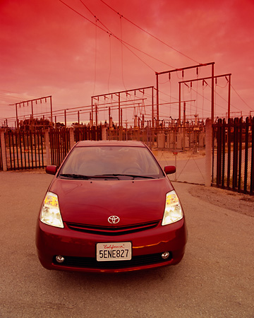 AUT 39 RK0184 06 © Kimball Stock 2004 Toyota Prius Red Wide Angle