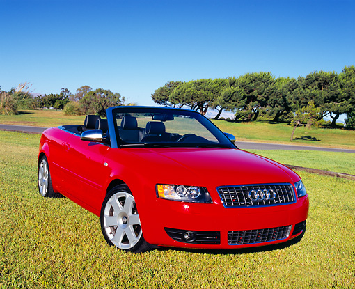 AUT 39 RK0258 06 © Kimball Stock 2004 Audi S4 Cabriolet quattro Red 3/4 Front View On Grass By Trees