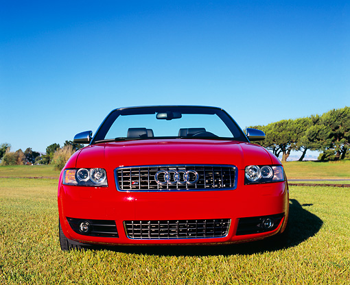 AUT 39 RK0261 02 © Kimball Stock 2004 Audi S4 Cabriolet quattro Red Head On View On Grass Blue Sky