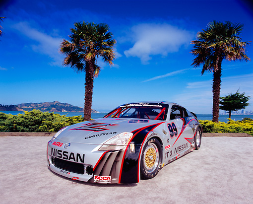 AUT 39 RK0268 03 © Kimball Stock 2004 Nissan 350Z GT3 Race Car 3/4 Front View By Palm Trees Blue Sky