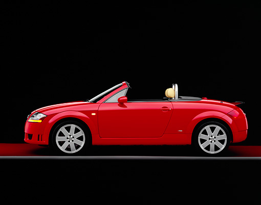 AUT 39 RK0275 01 © Kimball Stock 2004 Audi TT Roadster quattro Red Profile View Studio