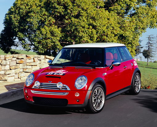 AUT 39 RK0323 01 © Kimball Stock 2004 Mini Cooper S Red And White 3/4 Front View On Bridge By Trees