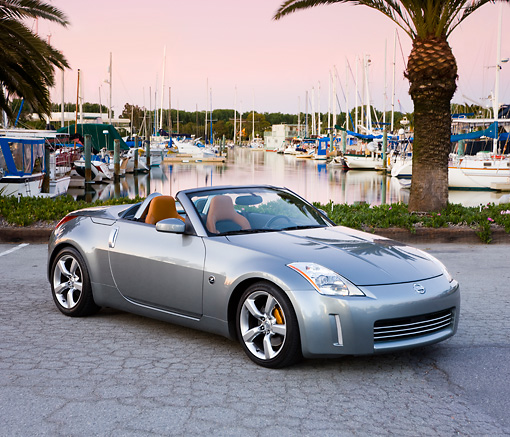 AUT 39 RK0382 01 © Kimball Stock 2004 Nissan 350Z Silver 3/4 Front View By Marina Palm Trees Blue Sky