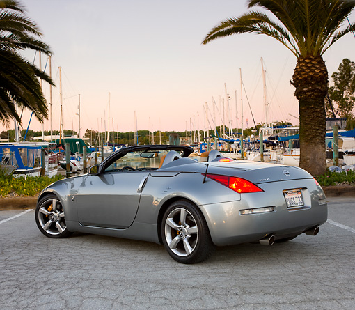 AUT 39 RK0383 01 © Kimball Stock 2004 Nissan 350Z Silver 3/4 Rear View By Marina Palm Trees Blue Sky