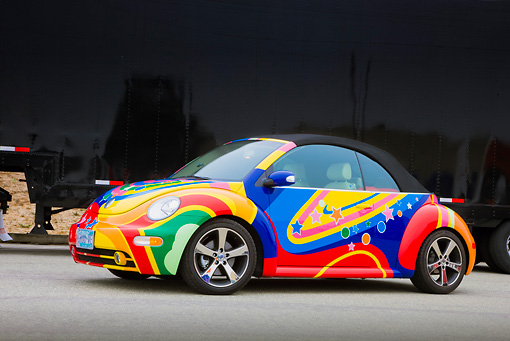 AUT 39 RK0387 01 © Kimball Stock 2004 Volkwagen New Beetle Turbo Psychedelic 3/4 Front View On Pavement By Trailer
