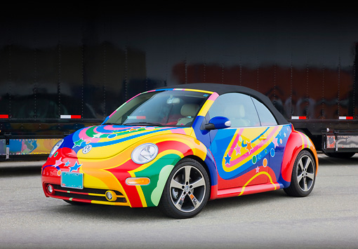 AUT 39 RK0388 01 © Kimball Stock 2004 Volkwagen New Beetle Turbo Psychedelic 3/4 Front View On Pavement By Trailer