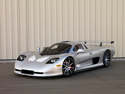AUT 39 RK0392 01 © Kimball Stock 2004 Mosler MT900S Silver 3/4 Front View On Pavement