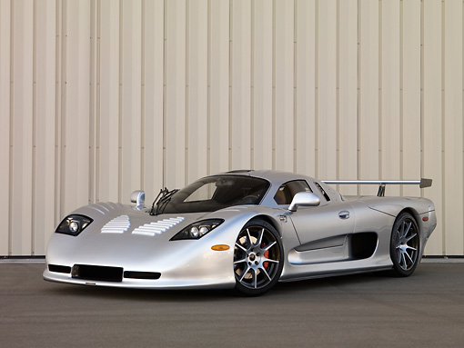AUT 39 RK0393 01 © Kimball Stock 2004 Mosler MT900S Silver 3/4 Front View On Pavement