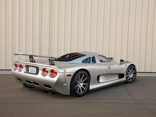 AUT 39 RK0398 01 © Kimball Stock 2004 Mosler MT900S Silver 3/4 Rear View On Pavement