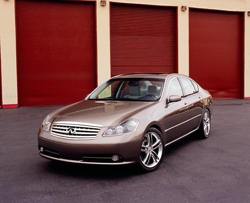 AUT 40 RK0047 02 © Kimball Stock 2005 Infiniti M45 Pewter Front 3/4 View On Pavement By Garage Doors