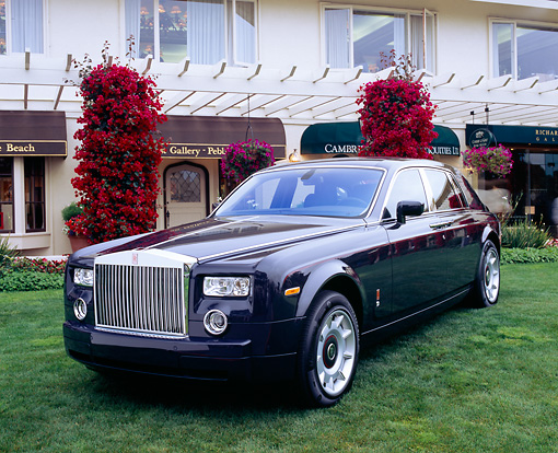 AUT 40 RK0055 04 © Kimball Stock 2005 Rolls-Royce Centenary Edition Phantom Blue 3/4 Front View On Grass By Building