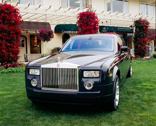 AUT 40 RK0055 05 © Kimball Stock 2005 Rolls-Royce Centenary Edition Phantom Blue 3/4 Front View On Grass By Building