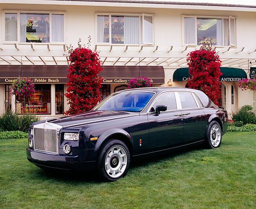 AUT 40 RK0055 08 © Kimball Stock 2005 Rolls-Royce Centenary Edition Phantom Blue 3/4 Front View On Grass By Building