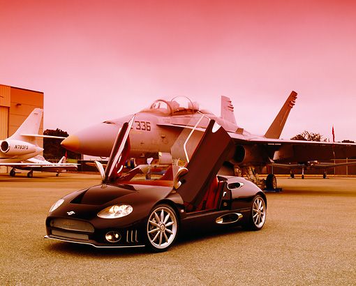 AUT 40 RK0061 03 © Kimball Stock 2005 Spyker C8 Spyder Black 3/4 Front View Doors Open On Pavement By Fighter Jet