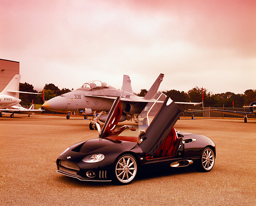 AUT 40 RK0065 03 © Kimball Stock 2005 Spyker C8 Spyder Black 3/4 Front View Doors Open On Pavement By Fighter Jet