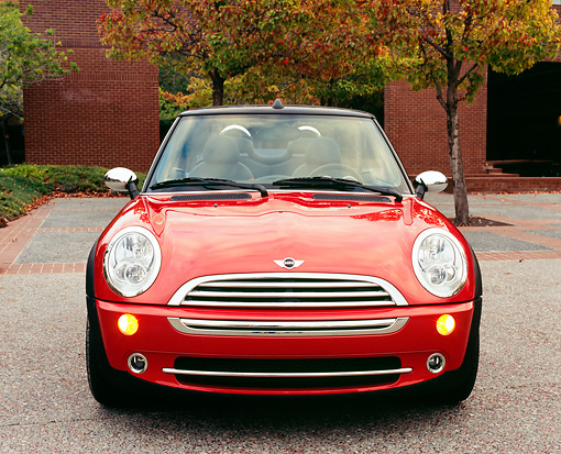 AUT 40 RK0077 02 © Kimball Stock 2005 Mini Cooper Convertible Orange Head On Shot On Pavement