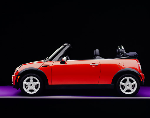 AUT 40 RK0081 04 © Kimball Stock 2005 Mini Cooper Convertible Orange Side View On Purple Floor Gray Line Studio