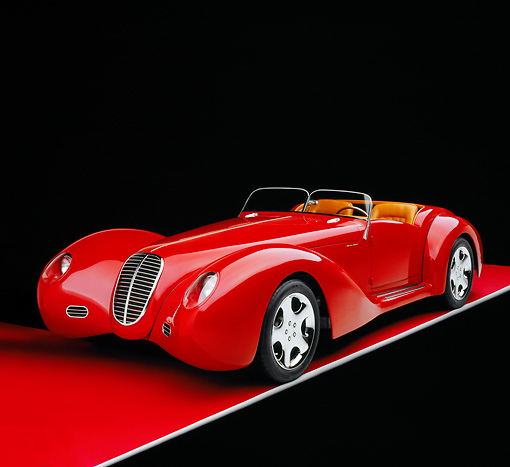 AUT 40 RK0082 09 © Kimball Stock 2005 Apollo Monza Spyder Red 3/4 Front View On Red Floor Studio