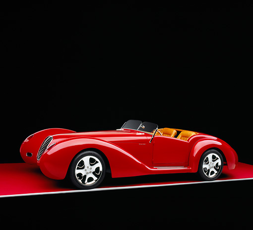 AUT 40 RK0084 01 © Kimball Stock 2005 Apollo Monza Spyder Red 3/4 Front View On Red Floor Gray Line Studio