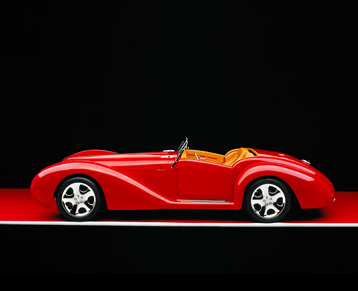 AUT 40 RK0085 01 © Kimball Stock 2005 Apollo Monza Spyder Red Profile View On Red Floor Gray Line Studio