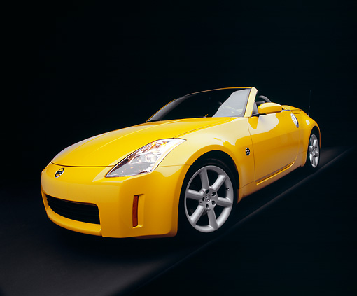 AUT 40 RK0109 05 © Kimball Stock 2005 Nissan 350Z Roadster Yellow Wide Angle 3/4 Front View Studio