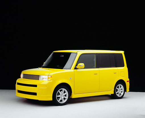 AUT 40 RK0141 06 © Kimball Stock 2005 Scion XB Yellow 3/4 Side View On White Seamless Floor Studio