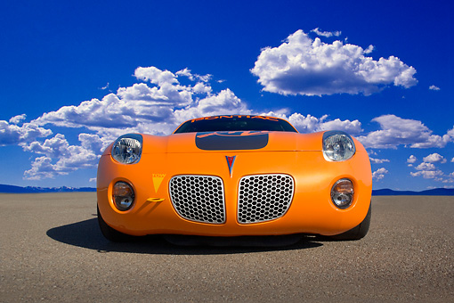AUT 40 RK0251 01 © Kimball Stock 2005 Pontiac Solstice Orange Low Head On View On Pavement