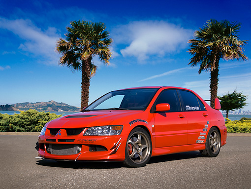 AUT 40 RK0255 01 © Kimball Stock 2005 Mitsubishi Lancer Evolution VIII Red Low 3/4 Front View On Pavement