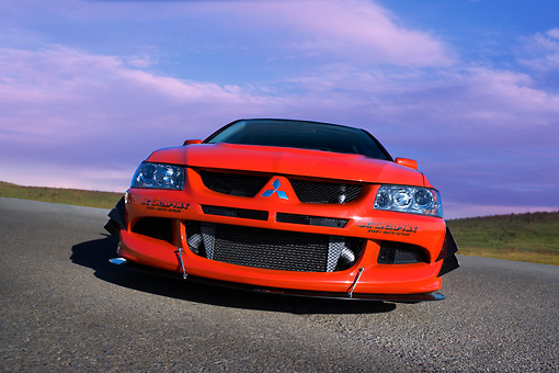 AUT 40 RK0259 01 © Kimball Stock 2005 Mitsubishi Lancer Evolution VIII Red Low Head On View On Pavement