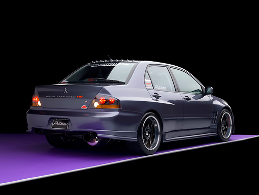 AUT 40 RK0262 01 © Kimball Stock 2005 Mitsubishi Evolution VIII MR Edition Gray 3/4 Rear View Studio