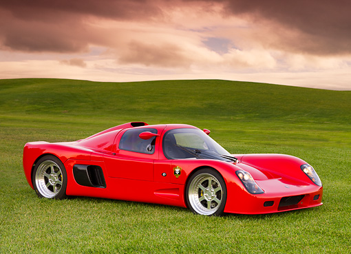 AUT 40 RK0276 01 © Kimball Stock 2005 Ultima GTR Red 3/4 Front View On Grass By Trees Sky
