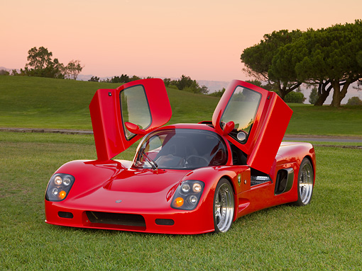 AUT 40 RK0278 01 © Kimball Stock 2005 Ultima GTR Red 3/4 Front View Doors Open On Grass By Trees Sky